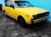 Vendo toyota corolla amarillo 4 puertas, economico, año 1976